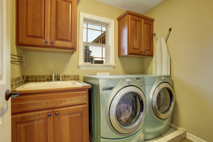 simple laundry room with tile floor and appliances.